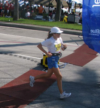 Sheila runs across the finish line