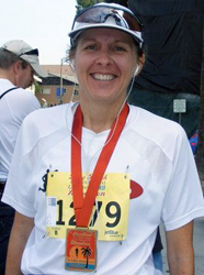 Sheila Poses with her Finishers Medal from the Long Beach 2007 Marathon